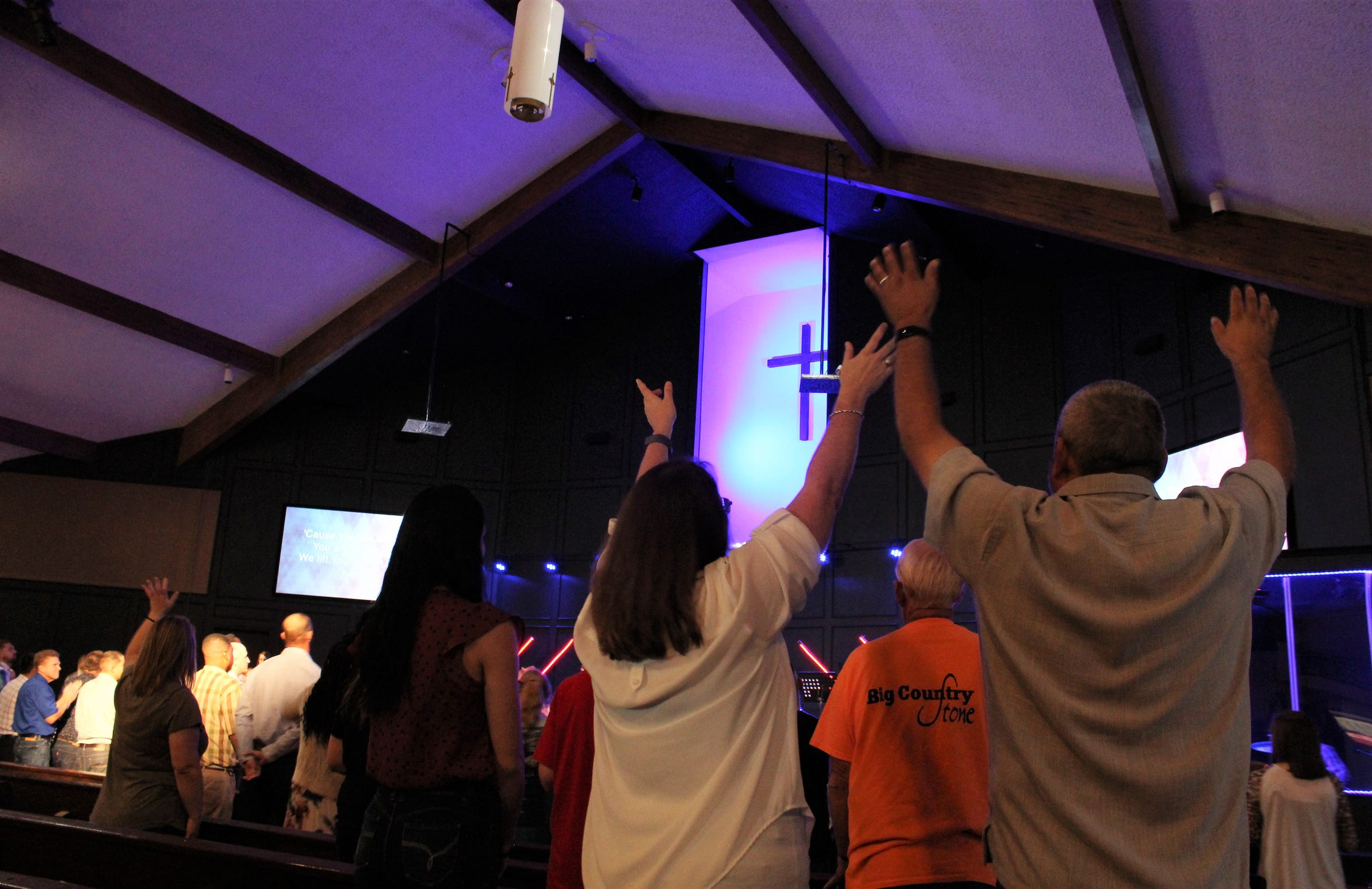 Rise Church worshipers raise their hands in hallelujah during an Oct. 6 service at their new site on the Elmcrest Baptist Church campus Rise was deeded and now shares with Elmcrest.