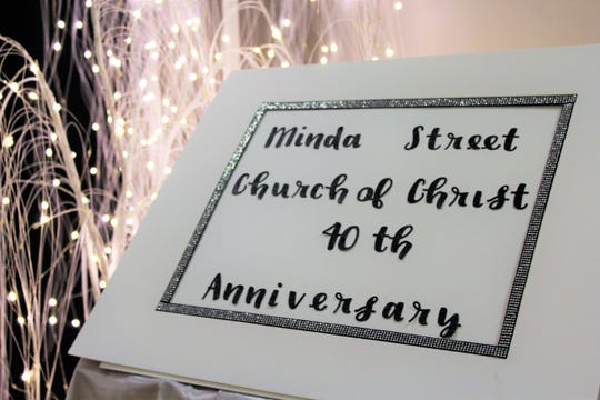 A sign at the entrance to a banquet hall at the Garrison Center on the McMurry campus, where the Minda Street congregation and others celebrated the church's milestone Saturday evening. Oct 19 2019