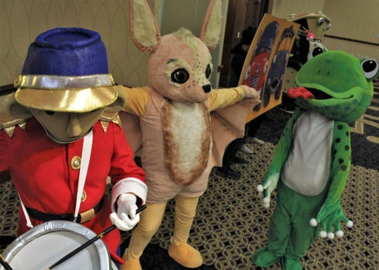 Drummer boy, Chirro the bat and Frog, characters created by illustrator Loren Long, made a grand appearance at the end of Wednesday's Celebrate the Arts in Abilene luncheon at Abilene Christian University.