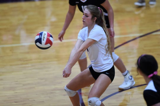 Wylie libero Pierson Sanders (1) looks in to return a serve against Wichita Falls High at Bulldog Gym on Tuesday, Oct. 22, 2019. The Lady Bulldogs won 25-6, 25-12, 25-15.