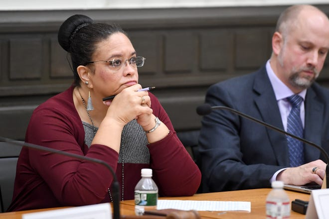 Carol Goins, chair of the Civil Service Board, listens to attorneys' arguments during a Civil Service Board hearing regarding a grievance made by Asheville Fire Department Division Chief Joy Ponder at Asheville City Hall on Oct. 23, 2019. The City filed a motion to dismiss Ponder's grievance for being involuntarily transferred. The board sided with the City and will not grant a hearing for the grievance.