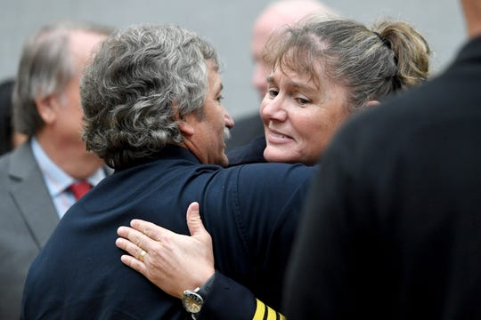 Fellow firefighters show their support for Joy Ponder, Asheville Fire Department Division Chief, during the closed session of a Civil Service Board hearing regarding a grievance she filed at Asheville City Hall on Oct. 23, 2019. The City filed a motion to dismiss Ponder's grievance for being involuntarily transferred. The board sided with the City and will not grant a hearing for the grievance.