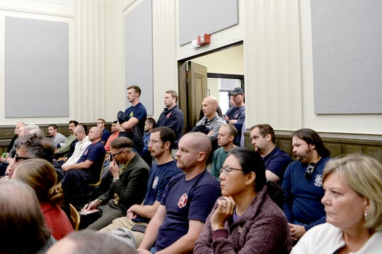 Audience members, made mostly of members of the Asheville Fire Department spill out of a standing-room-only Civil Service Board hearing regarding a grievance made by Asheville Fire Department Division Chief Joy Ponder at Asheville City Hall on Oct. 23, 2019. The City filed a motion to dismiss Ponder's grievance for being involuntarily transferred. The board sided with the City and will not grant a hearing for the grievance.