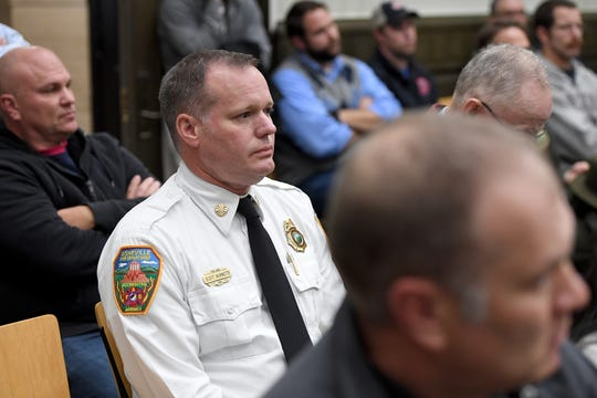 Asheville Fire Department chief Scott Burnette listens from the audience during a Civil Service Board hearing regarding a grievance made by Asheville Fire Department Division Chief Joy Ponder at Asheville City Hall on Oct. 23, 2019.