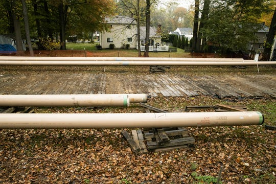 In this Tuesday, Oct. 22, 2019 photo, pipes lay along a construction site on the Mariner East pipeline in a residential neighborhood in Exton, Pa. The 350-mile (560-kilometer) pipeline route traverses those suburbs, close to schools, ballfields and senior care facilities. The spread of drilling, compressor stations and pipelines has changed neighborhoods — and opinions.  (AP Photo/Matt Rourke)