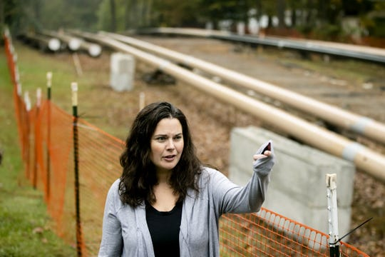 "In this Tuesday, Oct. 22, 2019 photo, Carrie Gross speaks during an interview with The Associated Press along the Mariner East pipeline in Exton, Pa. The pipeline route traverses those suburbs, close to schools, ballfields and senior care facilities.  ""It's absolutely traumatic and I don't say that to exaggerate or cry wolf,"" said Gross, referring to the project that runs through backyards in her middle-class Philadelphia suburb of Uwchlan Township. ""It's devastated my neighborhood.""  (AP Photo/Matt Rourke)"