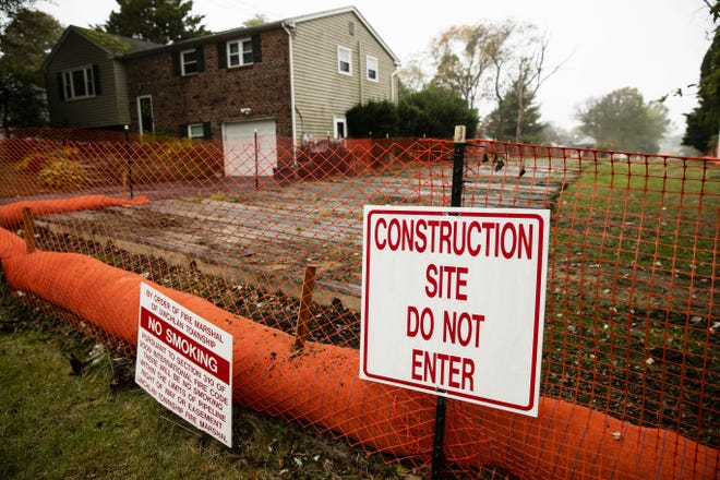 In this Tuesday, Oct. 22, 2019 photo, a sign is posted at a construction site on the Mariner East pipeline in a residential neighborhood in Exton, Pa. The 350-mile (560-kilometer) pipeline route traverses those suburbs, close to schools, ballfields and senior care facilities. The spread of drilling, compressor stations and pipelines has changed neighborhoods — and opinions.  (AP Photo/Matt Rourke)