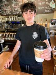 August Perez serves hot tea at Mima's Café & Tea Bar in Cocoa Village.