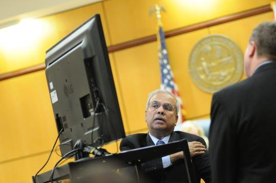 Medical Examiner Sajid Qaiser speaking in court in 2014.
