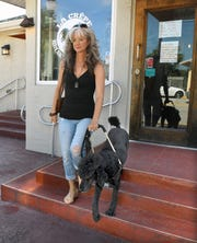 Jennifer Cleveland, who is legally blind, relies on her service dog, Frank, to get her safely around town.