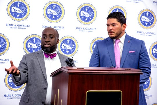Nueces County District Attorney's Office First Assistant Matt Manning, left, and district attorney, Mark Gonzalez, talk about an application available to victims of violence to help them document violence during a press conference on Wednesday, October 23, 2019. The app, Victims Voice, is available to anyone who needs it, regardless of whether they live in Nueces County, they said.