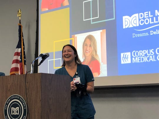 Samantha Hooper, a 31-year-old certified nurse aide at Corpus Christi Medical Center, speaks about completing her training thanks to a Texas Workforce Commission grant during a press conference at the Del Mar College Center for Economic Development on Wednesday, Oct. 23, 2019.