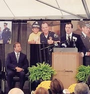 Former Camden County Police Chief Scott Thomson, right, speaks at a ceremony in Camden Tuesday.