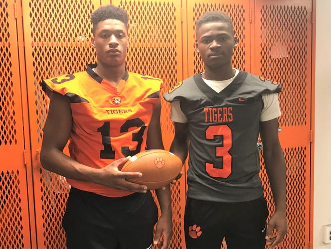 Woodrow Wilson's Dyshier Clary, left, and Malik Harvey each  had late starts to their football careers, but both landed spots with Division-1 programs.
