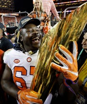 Eagles defensive tackle Albert Huggins celebrates after winning the National Championship with Clemson in January. The Eagles signed Huggins off the Houston Texans practice squad on Monday.