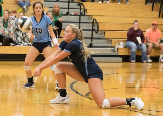 Adena's Ellie Harper digs a ball during a 3-1 win over Nelsonville York Tuesday night at Waverly High School in a Division III district semifinal.