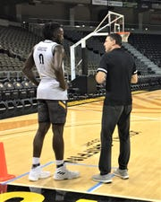 NKU head coach Darrin Horn talks with post player Silas Adheke as Northern Kentucky University basketball had practice October 22, 2019.