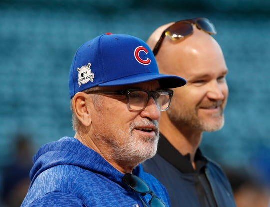 Joe Maddon (left) with former catcher David Ross before Game 4 of the 2017 NLCS playoff baseball series against the Los Angeles Dodgers at Wrigley Field.