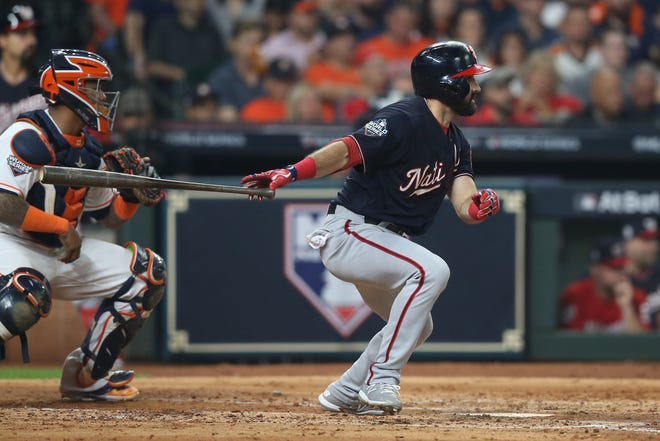 Washington Nationals right fielder Adam Eaton (2) hits a single against the Houston Astros during the third inning of Game 1 of the 2019 World Series at Minute Maid Park on Oct. 22.