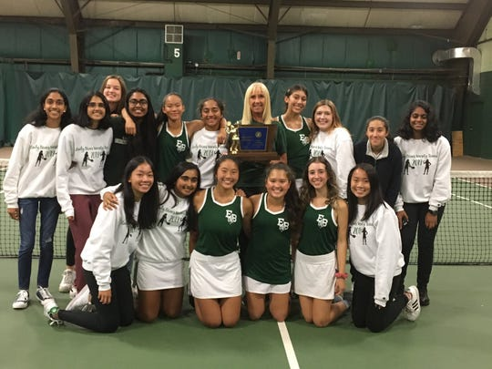 The East Brunswick girls tennis team poses after winning the 2019 Tournament of Champions