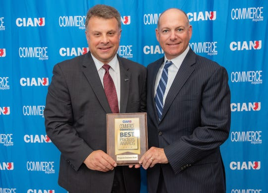 The Commerce and Industry Association of New Jersey held its annual Best Practices Conference on Sept. 24 at Nanina's in the Park in Bellville. Among the winners was Peapack-Gladstone Bank. Pictured are Anthony Russo, left, the association's president, and Stuart Vorcheimer, the bank's senior managing director and market president.