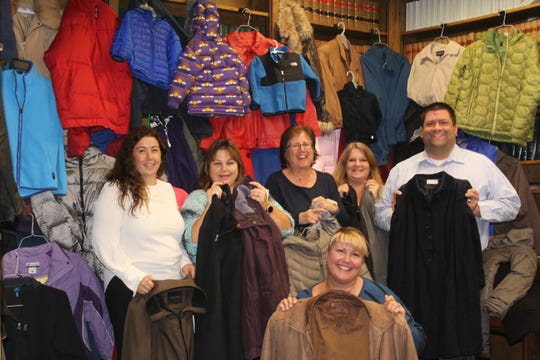 Staff at Gebhardt & Kiefer Law Offices get ready to pack 135 coats for donation to the Hunterdon County YMCA's winter coat drive. (Left to right) Diana Fredericks, Lisa Arrigo, Gail Gitch, Jennifer Neves, Sondra Bauchspies, and Dan Makoski.
