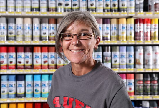 Amy Taylor is the paint expert at Auer Ace Hardware in Coshocton. She is also a co-coordinator of the Indian Mud Run race.
