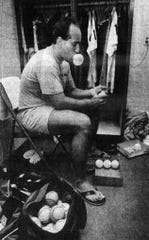 From 1991: Eric Cooper takes the shine off a batch of new baseballs by rubbing mud into them while he waits in his crowded locker room before a Class A Midwest League in July 1991. The special mud from Mississippi, smooth and creamy so it does not score the surface, is blended with some spit, a little soda pop and some chewing tobacco residue, then worked into the ball's surface. Cooper prepared two dozen to three dozen new balls in this fashion for each game.