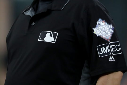 Umpires wear a new patch on their left sleeve for the late umpire Eric Cooper in Game One of the 2019 World Series between the Houston Astros and the Washington Nationals at Minute Maid Park on October 22, 2019 in Houston, Texas.