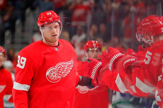 Detroit Red Wings right wing Anthony Mantha (39) receives congratulations from teammates after scoring in the first period against the Vancouver Canucks at Little Caesars Arena on Tuesday, Oct. 22, 2019, in Detroit.