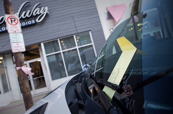 A parking ticket is placed on a car's windshield on S. Washington St. in Royal Oak,  Mich. on Monday, Oct. 21, 2019.