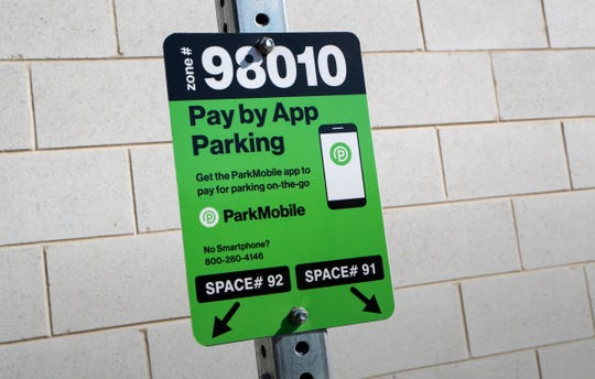 A parking space that uses the ParkMobile parking app is seen in Royal Oak, Mich. on Monday, Oct. 21, 2019.