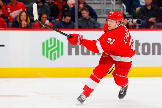 Detroit Red Wings defenseman Dennis Cholowski (21) takes a shot and scores in the second period against the Vancouver Canucks at Little Caesars Arena on Tuesday, Oct. 22, 2019, in Detroit.