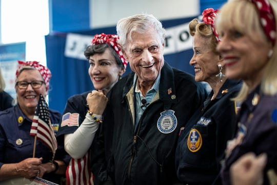 Jack Eaton, 100, the oldest living sentinel of the Tomb of the Unknown Soldier, shares a laughter with Willow Run Tribute Rosie the Riveters as he poses for a photo at the Detroit Metropolitan Airport in Romulus, Wednesday, Oct. 23, 2019.