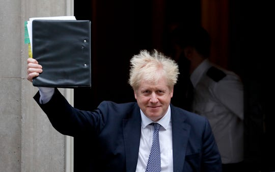 Britain's Prime Boris Johnson leaves 10 Downing Street to attend the weekly Prime Ministers' Questions session, in parliament in London, Wednesday, Oct. 23, 2019.