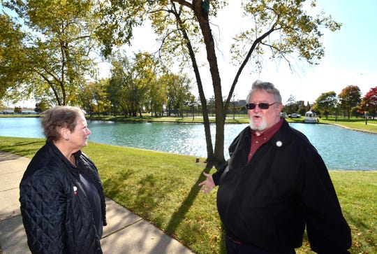 Harbortown residents Dr. Janet Bobby and Keith King say their view of the Detroit River would be blocked if developers build new condos in the green space and wooded area behind this pond.