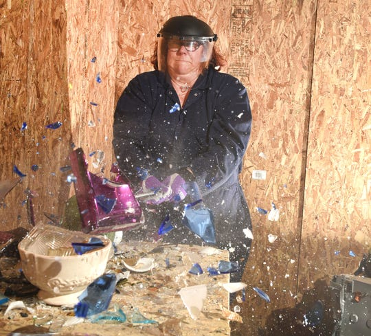 Rose Snowwhite of Dexter smashes glassware at the Destruction Depot in Whitmore Lake on October 22, 2019.