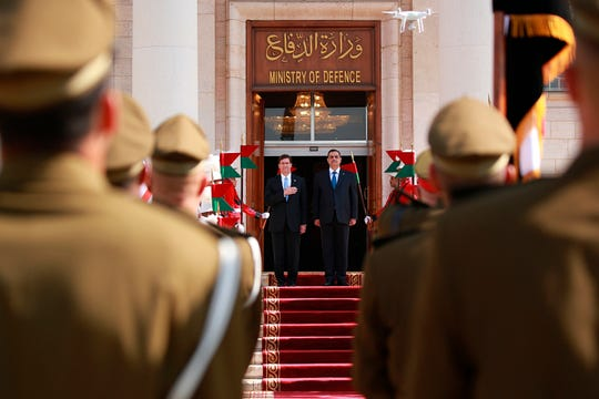 Iraqi Defense Minister Najah al-Shammari, center right, and U.S. Defense Secretary Mark Esper, center left, stand for their country's national anthems during a welcome ceremony at the Ministry of Defense, Baghdad, Iraq, Wednesday, Oct. 23, 2019.