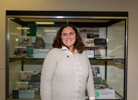 Head of the MSU Map Library, Kathleen Weesies stands in front of the Detroit Green Book exhibit on Oct. 17, 2019 at the Michigan State University Library.