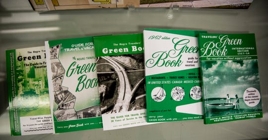 Various editions of the Green Book are displayed as part of the Detroit Green Book exhibit at the Michigan State University Library.