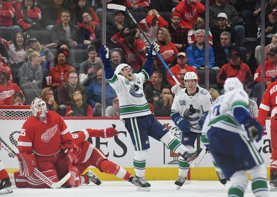 The Canucks' Bo Horvat celebrates his second of three goals in the third period.