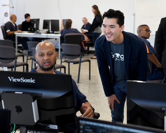 Google.org employee Jon Cook, right, works with Parnall Correctional Facility inmate Terrance Ray on his web design project, Oct. 22 in the prison in Jackson. Google.org is teaming up with The Last Mile to provide computer coding and web development training to Michigan's learners behind bars. The Last Mile is a non-profit founded in 2010 at San Quentin State Prison with the mission to provide marketable skills to incarcerated individuals.
