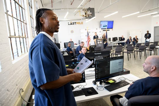 Parnall Correctional Facility inmate Brian Allen describes the progress his team has made on their NFL Fantasy Football website, during a training session on computer coding and web design.