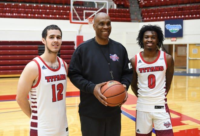 From left, University of Detroit Mercy basketball player Brad Calipari, head coach Mike Davis and returning leading scorer Antoine Davis pose during media day Wednesday in Detroit.