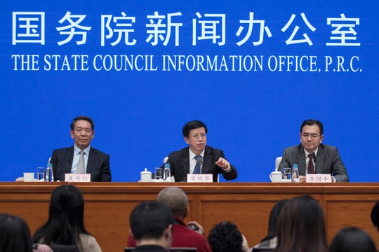 In this Jan. 14, 2019, photo released by Xinhua News Agency, Wu Yanhua, center, vice chairman of the China National Space Administration speaks during a press conference on Chang'e-4 mission, at the State Council Information Office in Beijing.