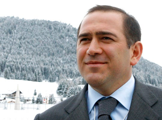 In this Jan. 26, 2011 file photo Akhmed Bilalov speaks with the press in Davos, Switzerland. Bilalov, a former Russian Olympic Committee official, who fled the country following accusations by Vladimir Putin was arrested Tuesday, Oct. 22, 2019, at his home in Sunny Isles, Fla., on an alleged immigration violation.