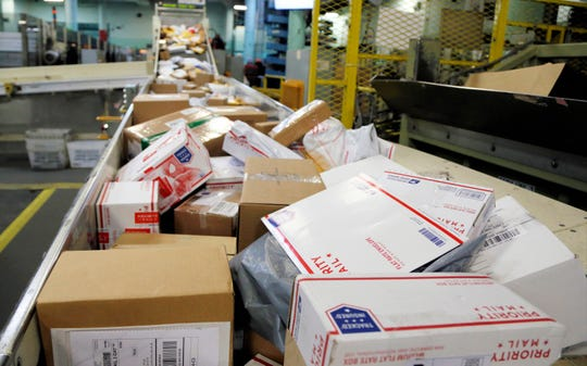 California and New York City sued the U.S. Postal Service on Tuesday to stop tens of thousands of cigarette packages from being mailed from foreign countries to U.S. residents, saying the smugglers are engaging in tax evasion while postal workers look the other way.