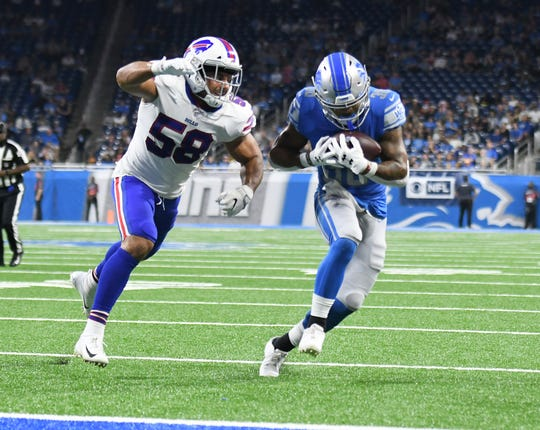 Lions rookie running back Ty Johnson, right, will look to pick up the slack following Kerryon Johnson's injury.