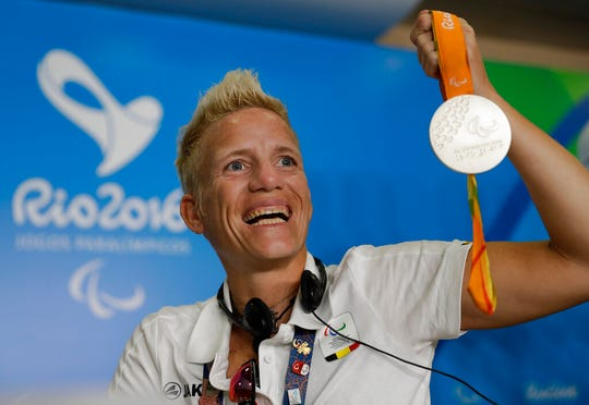 In this Sept. 11, 2016, file photo, Belgium's Marieke Vervoort poses for the photo as she holds her silver medal at a press conference during the Rio Paralympic games in Rio de Janeiro, Brazil.