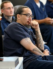 Parnall Correctional Facility inmate John Mannion listens to Google.org employee  Jasmine Rishi during their training session on computer coding and web design.